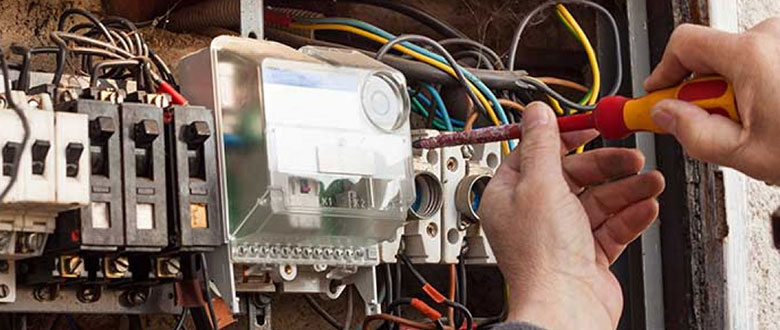 an electrician working on an electrical panel upgrade